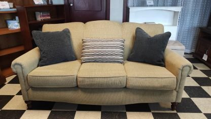 TAN SOFA WITH CURVED ARMS 1